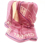 Chanel silk scarf in pink with yellow logo print